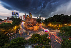 Storm is coming (Jackie Tran Anh) Tags: saigon vietnam hochiminhcity longexposure lights storm clouds raining lightning castle church city trees