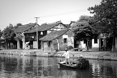 Xuchang waterway (Frhtau) Tags: china water way wasser weg river man boat boot transportation xuchang historic history buildings architecture  peoples republic   pinyin chn ji  people worker sign chinese place outdoor gebude architektur gabeldach dach zweirad building dynasty personen