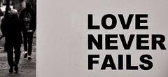 Love never fails, London, 2014 (MJ_Conlon) Tags: road street city uk england people white black london art sign walking graffiti coat hoarding suit