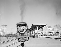 [Locomotive 653 at Depot, Texas & Pacific Railway Company] (SMU Central University Libraries) Tags: trains tp locomotives railroads trainstations tenders depots texaspacificrailway texasandpacific