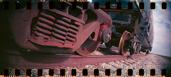 (No Stone Unturned Photography) Tags: railroad arizona film car train 35mm lomo lomography kodak wheels tracks holes springs 400 fuel sprockets sprocketholes ultramax