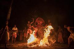Theyyam (Ravikanth K) Tags: travel light red people india festival night fire dance dangerous jump village outdoor low crowd group performance culture belief kerala gods ritual tradition act stunt kelan rituals malabar theyyam kannur kasargod 500px vellatam kandanar