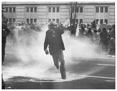 Lone demonstrator framed by tear gas: 1969 (washington_area_spark) Tags: november 1969 march justice dc washington war rally protest police 15 gas vietnam demonstration massive antiwar clubs strike tear fighting anti department arrest picket indochina throngs moratorium