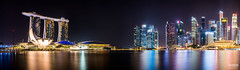 Marina Bay Panorama (davidgevert) Tags: longexposure panorama skyscraper singapore cityscape d800 singaporecityscape marinabay travelphotography megacity helixbridge marinabaysands nikon2470mmf28 nikond800 cityscapepanorama davidgevert gevertphotography