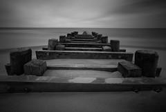 Asbury Park beach (roken-roliko) Tags: ocean park longexposure sky blackandwhite usa white seascape black beach america landscape grey sand fineart asburypark asbury rolandshainidze