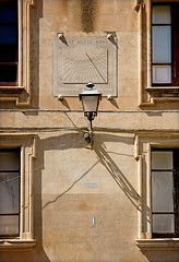 Two Sundials (hogsvilleBrit) Tags: shadow italy building window lamp wire streetlight cable symmetry sundial electricity sicily trapani