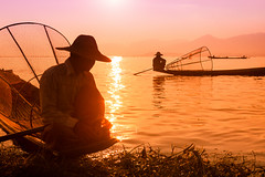 Sunset. Inle lake, Myanmar (Marji Lang Photography) Tags: travel light sunset two people sunlight lake tourism water horizontal outdoors photography golden fishing warm fishermen dusk pastel burma traditional fineart working colorphotography documentary atmosphere destination myanmar inlelake persons shan tones burmese sunbeam magichour goldenhour touristic shanstate goldenlight intha travelphotography nyaungshwe traveldestination lacinle myanma visitmyanmar travelimage taunggyidistrict marjilang inthafishermen travelinburma