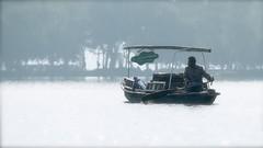 """I am loud and the morning is silent."" (Marie.L.Manzor) Tags: china asia hangzhou lake boat morning fisherman water backlight mist westlake nikon nikon610 marielmanzor nikkor bokeh focus dof mood wow 1000favs 1000favorites fog 2016"