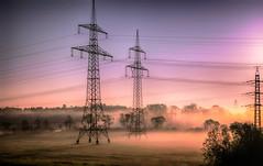 electric avenue - remastered ;o) (Florian Grundstein) Tags: sunrise sunray sunny morninglight morning foggy fog misty orange dreamlike powerpoles panasonic dmcgm1 workway grundstein florian