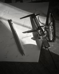 Found Objects, Morning Sun Splash (fotographis) Tags: leica leicam240 leicam summicron 35mmsummicron stilllife shadow sunrise blackwhite blackandwhite monochrome pencil glasses caliper