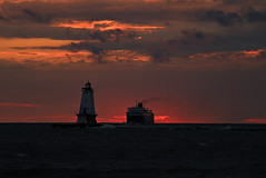 Smokey sunset (GLC 392) Tags: sunset red orange lighthouse lake water grass car weather ferry clouds waves wind michigan smoke system badger co coal chessie lmc ludington