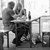 Two Bottles of Beer - or - What About Me? (Anne Worner) Tags: street people blackandwhite bw woman dog man beer monochrome lensbaby bench table mono waiting labrador sad eating candid drinking streetphotography olympus tent tourists buns disappointed dining rolls hungry bergen torget composer poorthing selectivefocus ignored fisketorget preset repast tonalrange selectivefocuslens niksoftware silverefex personalpreset sweet35 anneworner littledoglaughednoiretblancet speedystreet