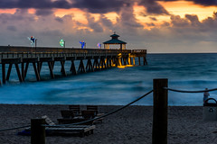 Sunrise (Jack Incredable) Tags: decorations sun beach water clouds zeiss sunrise landscape pier fishing sand san chairs sony deerfield 1670 a77ii