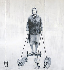 CATMAN (surreyblonde) Tags: uk bw white streetart black liz dogs monochrome canon graffiti stencil spray urbanart segway walls cans hrh royalty catman queenelizabeth walkies royalfamily corgis hoverboard g15
