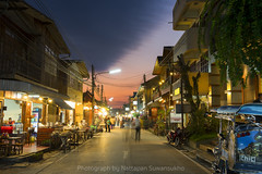 Loei , Thailand - Jan 28, 2016: Shoppers stroll through Chiang Khan Pedestrian Street. The street is the main shopping district of the city and a major tourist attraction. (nattapan.suwansukho) Tags: life road street city travel people urban abstract motion blur public silhouette modern night shopping way moving blurry focus soft cityscape crossing walk district background crowd lifestyle blurred running scene location communication business busy walkway rush pedestrians commuting concept activity crosswalk chiang anonymous effect connection commuters kan crowded defocused chiangkhan