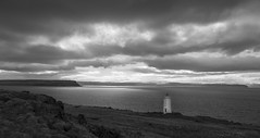 lighthouses always get the best views (lunaryuna) Tags: light bw panorama lighthouse seascape monochrome weather clouds season landscape coast blackwhite iceland spring solitude shore coastline southcoast lunaryuna stillness cloudscape northatlantic southiceland lightmood
