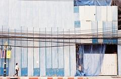 Cable Girl - Thong Lo, Bangkok (35mm) (jcbkk1956) Tags: street woman film analog 35mm walking thailand bangkok cables fencing manual streetfurniture buildingsite carlzeiss kodacolor200 thonglo contaxrts 45mmf28