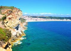 bluest water (ekelly80) Tags: portugal nazar june2016 summer cliffs water ocean atlanticocean clear leiria view scenery beautiful blue rocks beach sand below lookdown