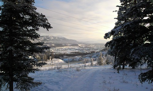 Mist rises over warming Yukon River. View of downtown Whitehorse from Yukon Arts Centre.