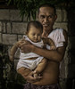 Father and Son (FotoGrazio) Tags: poverty family portrait baby painterly cute art proud infant asia father philippines poor bulacan portraiture bond filipino fatherandson fathersday chubby hold pinoy cradle badteeth chubbybaby boychild pacificislander baliuag fotograzio waynegrazio
