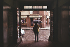 Rain (katherine.anne.) Tags: summer portrait people slr film umbrella 35mm lens person 50mm europe republic czech prague pentax k1000 study abroad analogue 2014