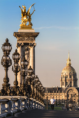 Invalides et Alexandre III (Michel Couprie) Tags: morning bridge summer man paris france statue canon walking eos streetlamp perspective walker invalides dome 7d pont michel risingsun alexandreiii rverbre couprie