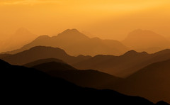 One step from the horizon (Robyn Hooz) Tags: sunset mountains montagne tramonto zoom horizon archive giallo sigh peaks orizzonte cime cansiglio archivio profili