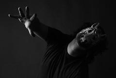 Animal Mask (C-Jay Adams) Tags: white black monochrome animal mask reaching stretch saving dying