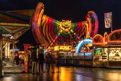 Chaotic Colors (Robert Bauernhansl) Tags: pink red blur men green rot rain yellow reflections linz gold lights austria amusement sterreich waiting ride flag blurred gelb grn funfair fahne mnner lichter verwischt warten jahrmarkt fahrgeschft buntelichter urfahranerjahrmarkt