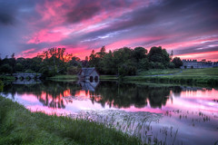 blood in the sky (BarryKelly) Tags: bridge house river boat carton
