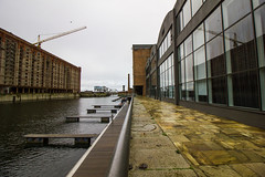 Titanic Hotel Liverpool (cathbooton) Tags: bridge urban reflection building history water architecture liverpool docks hotel factory angle crane wide wideangle warehouse titanic canoneos tobacco 10mm pavingstones canonusers