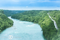 Niagara River Gorge (JohnBorsaPhoto) Tags: road blue trees wild summer sky plant canada green nature water beautiful beauty up leaves lines weather electric clouds america forest project river flow grid niagarafalls high wire skies escape power cloudy body dam branches united breath border mother scenic cable scene canadian niagara falls system rapids hydro cables wires gorge winding flowing states straight taking overlook tension span breathtaking lewiston voltage hydroelectric spanning queenston hydroelecric