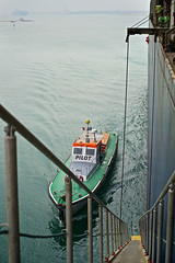 Pilot shuttle approaching freighter boat shell, Suez Canal, Red Sea, Egypt (Alex_Saurel) Tags: africa port boat harbour outdoor african photojournalism cargo deck shuttle pont nautical egypte 50mmf14 freighter afrique coque cargoship merchantship metallicboat