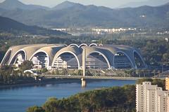 Rungrado May Stadium (CruisAir) Tags: city bridge architecture buildings river asia cityscape stadium north may games korea mass northkorea pyongyang dprk arirang taedong cruisair rungrado