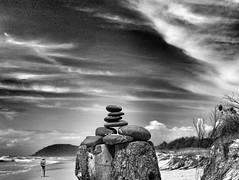 Cairn on angels beach (YAZMDG (15,000 images)) Tags: ocean trees bw beach monochrome clouds mono noiretblanc stones pebbles beachfront cloudscape cairn headland beachwalker angelsbeach