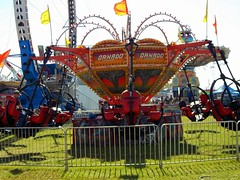 Amusements Of America Tornado Carnival Ride. (dccradio) Tags: carnival sc grass fence fun florence flag lawn southcarolina fair flags entertainment greenery countyfair tornado thrillride carnivalrides ringoffire amusementride communityevent fairrides superloops mechanicalride amusementdevice amusementsofamerica ridefence easterncarolinaagriculturalfair ecafair
