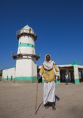 Big Mosque, Assaita, Afar Regional State, Ethiopia (Eric Lafforgue) Tags: africa travel people men vertical architecture outdoors photography worship day adult african balcony minaret muslim islam faith religion culture mosque tribal structure copyspace ethiopia tribe shape built oneperson hornofafrica ethiopian afar placeofworship t