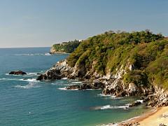 Oaxacan Coast (knightbefore_99) Tags: blue sea west green beach mexico coast rocks pacific south sunny mexican bahia oaxaca secrets conejos