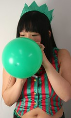 OK, OK! I'll Get More Green! (emotiroi auranaut) Tags: christmas xmas red party woman holiday cute green beautiful beauty hat japan lady toy japanese tokyo concentration costume pretty december seasonal balloon grow blowing blow effort growing lovely breathe bigger squeak breathing