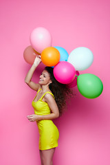 Young and beautiful curly girl in a yellow dress on a pink background holding colorful balloons (noor.khan.alam) Tags: birthday pink blue party portrait people woman white holiday cute beautiful beauty smile fashion yellow lady female hair studio fun happy person model holding colorful pretty dress emotion expression joy balloon young lifestyle style happiness celebration curly helium gift attractive leisure positive elegant cheerful belarus celebrate isolated caucasian