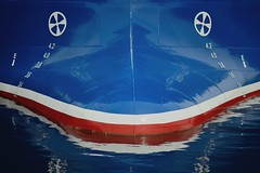 Crying bow face (Paul B. (Halifax)) Tags: canada water face reflections nikon novascotia redwhiteblue urbanabstract fishingvessel halifaxwaterfront afsvrmicronikkor105mmf28gifed d7000