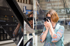 Sections of a Photographer (Torsten Reimer) Tags: windows woman usa chicago glass reflections mirror us illinois photographer unitedstates candid unitedstatesofamerica northamerica spiegelungen