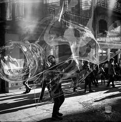 The art of making giant bubbles... (Srgio Miranda) Tags: street people blackandwhite bw 6x6 portugal mediumformat golf kodak trix streetphotography porto bubble streetperformer oporto filmphotography adox bwstreet filmisnotdead adoxgolf srgiomiranda squarephotography bwfilmphotography sergiomiranda