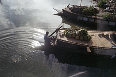 Ripple and Reflection.... (Sheikh Shahriar Ahmed) Tags: film water fruits analog boat canal cargo fujifilm dhaka bangladesh boatman banasree olympusmjuii fujicolorc200 dhakadivision pacificimage aftabnagar rampurakhal sheikhshahriarahmed primefilm3650pro3