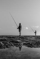 False twins (PMTN) Tags: sky blackandwhite man portugal monochrome clouds canon fishermen cu nuvens homem pretoebranco pescadores pedronascimento