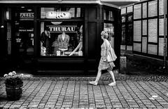 The finishing touch? (Mister G.C.) Tags: blackandwhite bw image streetshot streetphotography candid photograph people unposed monochrome urban town city woman lady female stripes striped dress clothes fashion window shop juxtaposition ricoh ricohgr pointshoot mistergc schwarzweiss strassenfotografie niedersachsen lowersaxony deutschland europe