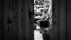 Working at night - Marsaxlokk, Malta - Black and white street photography (Giuseppe Milo (www.pixael.com)) Tags: street city urban blackandwhite bw white man black monochrome contrast geotagged photography photo europe fuji mt candid working streetphotography malta fujifilm marsaxlokk fujix xe2 fuji35 fuji3514 fujixe2