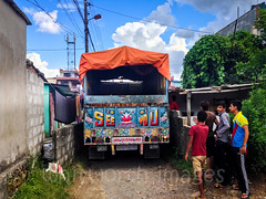Tight squeeze (whitworth images) Tags: street nepal people building male men truck outdoors asia space watching fences lane delivery vehicle tight pokhara narrow onlookers nepali reversing unpaved kaski