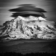 Mount Rainier Lenticular Sunset (TroyMasonPhotography) Tags: blackandwhite forests glacier ice landscape lenticular libertycap mountrainier mowich mtrainier peace pointsuccess ridge snow southtahomaglacier sunset sunsetamphitheater tahomaglacier tanwax tanwaxcountrychapel troymason troymasonphotography troytroymasonphotographycom troymasonphotographycom westside mowichface summit glacierisland nationalpark storm rain sleet weather