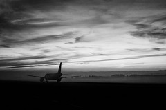 """Early Morning Flight"" (helmet13) Tags: bw silhouette fog sunrise airliner airfield aoi 100faves peaceaward heartaward world100f leicaxvario picturesfromtheairport"